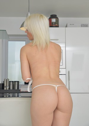 Blonde Evey Kristal is playing very sexy with her good-looking ass