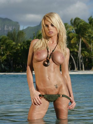 Babe blonde Jesse Jane poses with naked boobies in the ocean