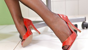 Awesome brunette Dominica Phoenix is playing with her red high heels