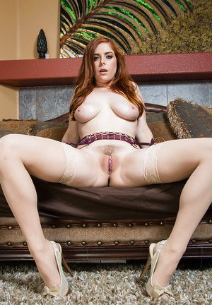 Sweet housewife Penny Pax poses with naked boobies in the bedroom