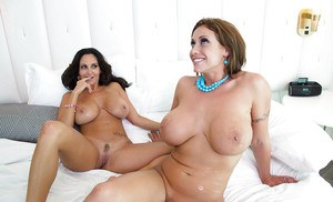 Ava Addams and Eva Notty are licking this tasty big prick on cam