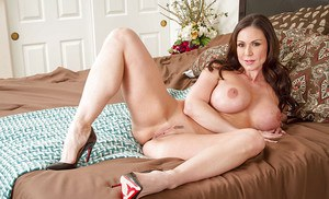 Milf Kendra Lust shows her absolutely great melons and bubble butt