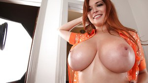 Redhead pornstar Tessa Fowler plays with her giant all-natural boobies