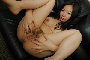 Mature Asian Ayumi Shoda undresses and plays with her anal gape