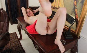 Clothed short-haired beauty Clarissa is lying and masturbating