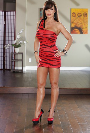Lisa Ann is taking off her dress and posing on sexy high heels