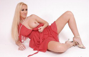 Milf Alana Evans is lying and playing with her cute orange panties