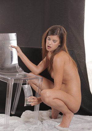 Slender brunette Candice is smiling and pissing before drinking