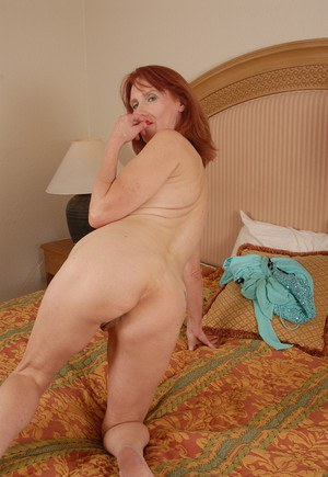 Redhead mature Debra is showing off her stunning ass in close-up
