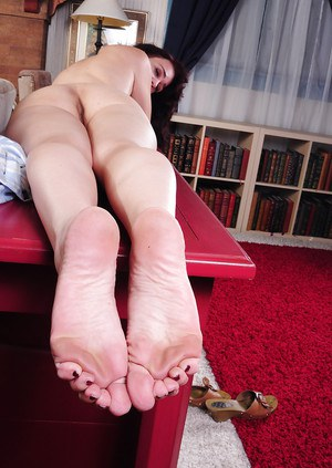 Sexy redhead mature Sable is undressing and doing an upskirt