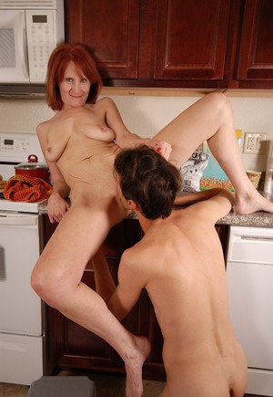 Redhead beauty Debra is being pounded by her old friend in the kitchen
