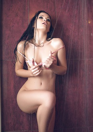 Innocent babe brunette Milena takes shower and plays with her tits