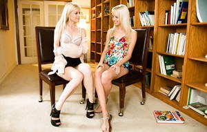 Lesbians blondes Sierra Nevada and Charlotte Stokely are kissing