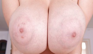 Teen Lucie Wilde plays with her nice natural big tits and toys