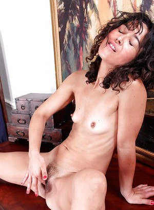 Ugly mature brunette Penelope is masturbating her pussy in close-up