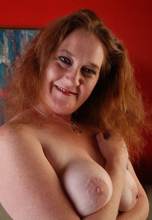 Fatty mature Rhonda is licking her own hard nipples in close-up