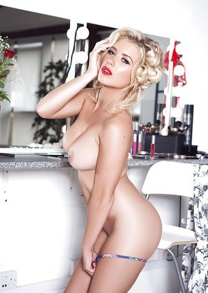 Teen blonde Azzra Hughes is posing in glamorous pin-up style