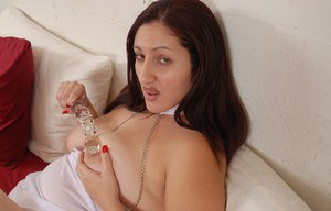 Fatty brunette Sonia is sucking this nice dildo and playing with puss