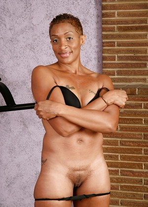 Ebony Donni is lying and stroking her lovely tasty vagina in the gym