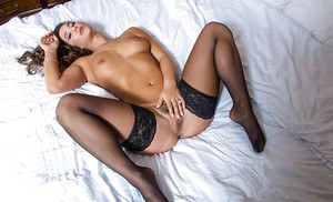 Stunning brunette Eva Lovia plays with her hot tanned boobies