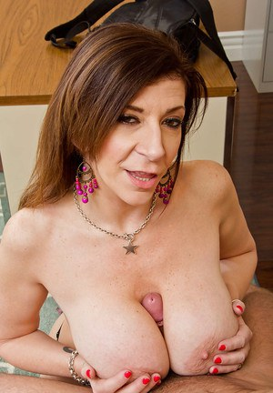 Mature teacher Sara Jay is sucking her stud's loaded with cum dick