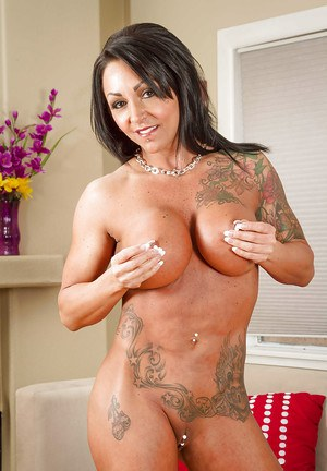 Brunette milf Ashton Blake is playing with her pierced nipples