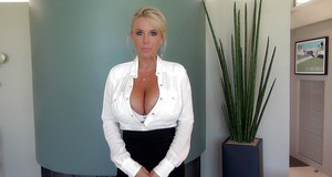 Busty mature housewife Sandra Otterson plays with her awesome tits