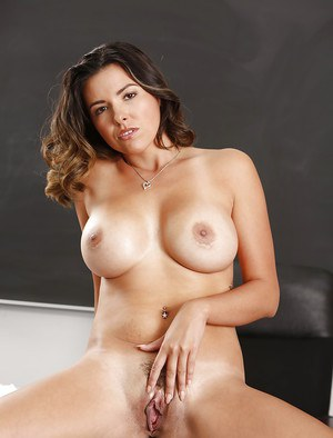 Babe milf Danica Dillon is posing with naked boobies on the table