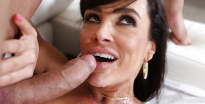 Mature brunette Lisa Ann is sucking balls and getting facial