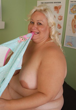 Fatty mature blonde Lisa is smiling while licking her big nipples