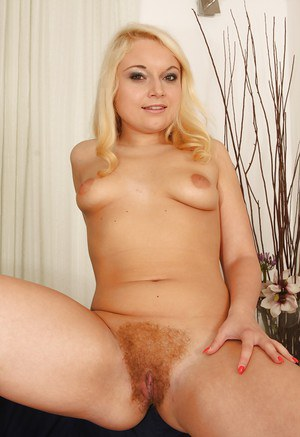 Slender blonde with saggy boobies Nicol White shows her hairy puss