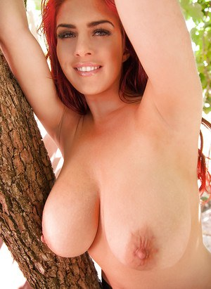 Big-tit redhead chick Robyn Alexandra is playing with her boobs