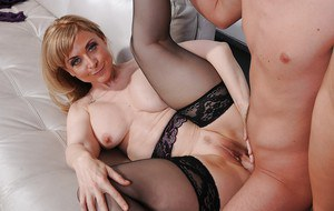 Sluts Nina Hartley and Britney Young are sucking this horny dong