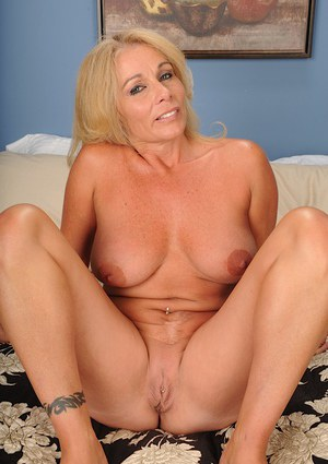 Stunning blonde Crystal Taylor takes off her black lingerie in the bed