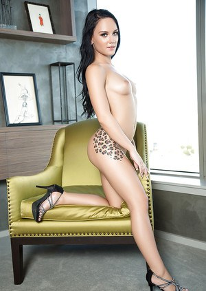 Beauty centerfold Meghan Leopard shows her tattooed naked shape
