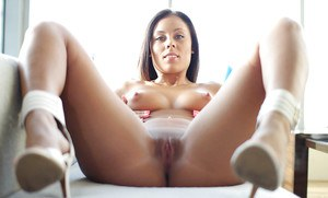 Sensual goddess brunette Gianna Nicole stretches her accurate pussy