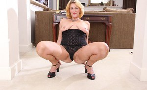 Mature Kelsey Johnson is lying on the floor and masturbating