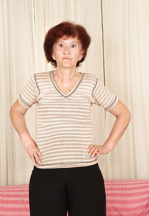 Redhead granny Marcelina shows herself naked in the bedroom!