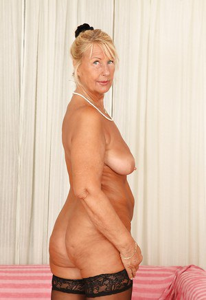 Short-haired blonde granny Regi is demonstrating her gorgeous boobs
