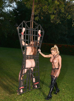 BDSM fetish scene with two slender babes Candy Sexton and Cherry Blush