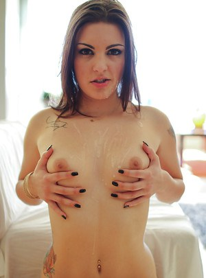 Slender tattooed brunette Rachael Madori is getting cum on her boobs