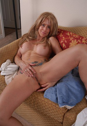 Young-looking granny Charlotte is stretching her cute pussy!