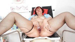 Fatty nurse Manka undresses her uniform and pokes juicy pussy