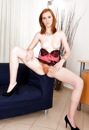 European redhead Linda Sweet demonstrates her hairy anal hole