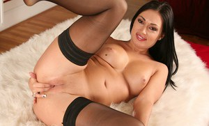 Sweet babe Rosaline Love is stretching her tight vagina on camera