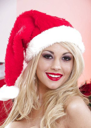 Spicy as hell young blonde Zoey Monroe posing in Christmas suite