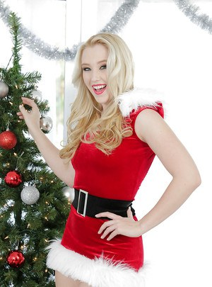 Teen blonde Harley Q is taking off her cute Christmas outfit!