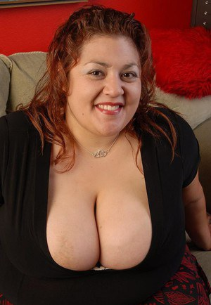 Fatty mature brunette Reyna undressing and demonstrating her tits