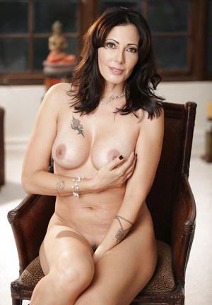 Mature brunette Zoey Holloway shows off her pretty hot big boobies