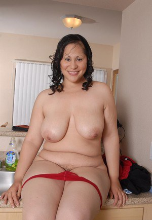 Fatty mature brunette Teedra poses in her sexy red lingerie!
